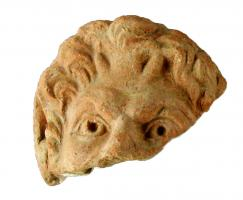 ANT-4017 -  *  Antefissa : Testa di satiro&#013 *  Antefix molded ornate facade of a satyr head with classic features , hair treated in small bits , ears stretched up without palmette around .
