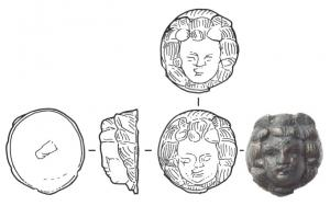 APM-4064 - *  Applies : head of Menade&#013*  Massive applies, without visible fixing , made ​​accordingly to be fixed by soldering on a metal surface area : brazier for example.  Tete young woman with hair framing the face symmetrically ( Menade ? ) .