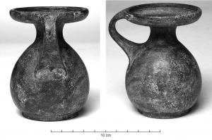 BLS-3007 - Balsamarium&#013 *  Balsamarium with globular body, necked and extended lip fitted with a small flat handle and thick, cut at the base to facilitate the solder on the shoulder.  Annular bottom hammered with a ring fitting .