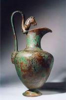 CRU-4018 -  *  Pitcher type Tassinari E.3000&#013&#013 *  Ewer narrow and curved neck , ovoid body with horizontal shoulder, strangled and set on a molded foot on its underside.  The neck forms a spout falling to one side.  The handle decorated with a protome animal ( horse , griffin ... ) , whose legs conform to the shape of the neck is raised , the lower attachment , attached below the shoulder is shaped mask ( or Gorgon  other ...) .