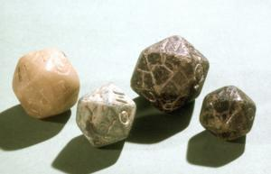 DEJ-4001 - Die : dodecahedral&#013&#013 *  Dodecahedral die in soft stone (steatite ) , the marked figures incised Greek count faces ( from alpha to upsilon letters).