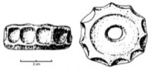 FUS-1009 -  *  Whorl single hull&#013&#013 *  Whorl patterned ceramic whose flank is marked with a central hull.  The two mouths of the central perforation are flared and slightly curved .  This copy has no decoration.