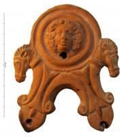 LMP-4331 -  *  Lamp Loeschcke IV: Mask and horses&#013 *  Lamp scrolls and arched beaks ; volutes ending on each side by a horse protome ; disk decorated with a Bacchic mask.  Orange clay with mica , dark brown slip almost entirely lost , flat base , lost cove head in relief.