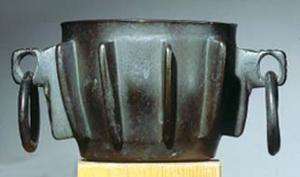 MRT-8002 -  *  Mortar ribs&#013 *  Mortar with a wide open flat bottom slightly curved sides are decorated with vertical ribs in high relief , which also act as reinforcements , two diametrically opposed ears are pierced with a round hole , which usually hang rings .