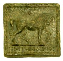 PDS-3002 -  *  Greek Weight: Seleucia Pieria&#013 *  Casting square plate with a relief on the upper face : horse walking right , head down, flanked by two inscriptions : above , <SELEYKION> ; below , <HMIMNAION> .
