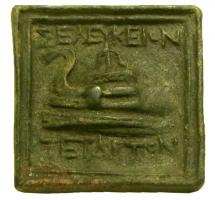 PDS-3004 -  *  Greek Weight: Seleucia Pieria&#013 *  Casting square plate with a relief on the upper face : prow left, flanked by two inscriptions : above , <SELEYKEION> ; below , <TETA...> .