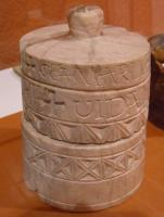 REL-6005 -  *  pyxis reliquary&#013 *  Pyxis cylindrical , multistage , and the outer wall is decorated with excised motifs and inscriptions ; lid uppermost button.