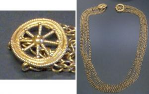 RUL-4001 -  *  Clasp Necklace : wheel&#013 *  Rouelle gold , realistic type, 8 spokes , wide rim often marked granulations hub is indicated and full.  The object may be suspended by means of an insert ring forming strip .