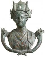 STE-4071 -  *  Statuette : Tutela&#013&#013 *  Female bust , resting on a shield, wearing a crown of battlements and flanked by two cornucopias .